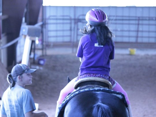 Camp Grin Again, an effort of Hospice of Wichita Falls, helps children facing grief. Horseback riding relieves stress.