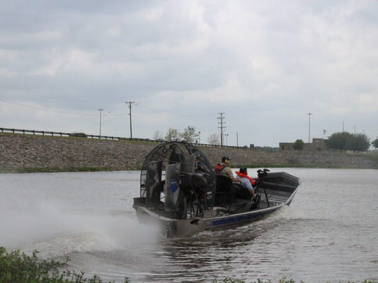 The Grant Parish Sheriff Office's new airboat launches into the Red River on Wednesday. The office was showing off the airboat and four other watercraft, giving rides to people to demonstrate.