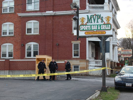 Police investigate near MVP's on Park Avenue West on Wednesday. One man was transported to OhioHealth Mansfield Hospital with multiple gunshot wounds.