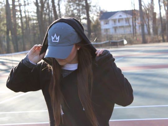 Danielle Regina, a Pompton Lakes native and senior at the University of Hartford, models one of the hats for QWN Apparel, a company she recently began out of her dorm room.