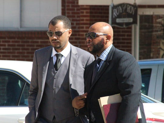 Defense attorneys Christopher LaCour (left) and Jonathan Goins arrive for the sentencing of their client, Derrick Stafford, on Friday morning in Marksville.