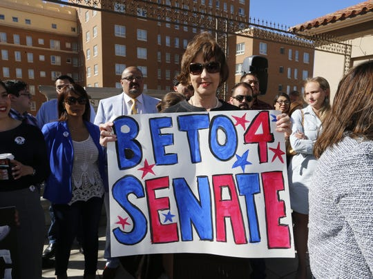 Congressman Beto O'Rourke's mother Melissa O'Rourke holds a sign announcing her son's run for Senate.