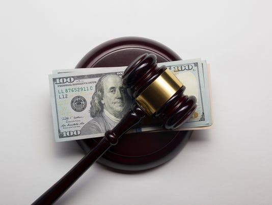 judge gavel and american dollars on white background