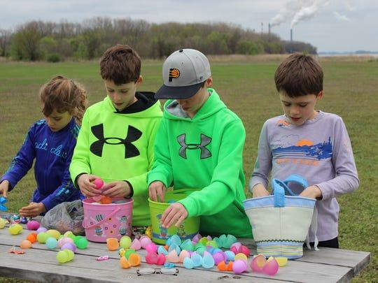 From left to right, Avery Slade, 7, Christian Slade, 11, Nolan Daughterty, 10, and Bennett Slade, 9, examine their Easter egg bounty