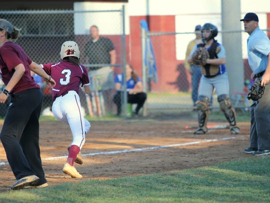 Caitlyn Ledford scores one of the Warlassies' 12 runs