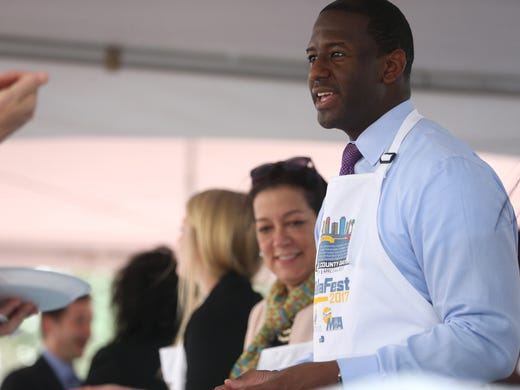 Mayor Andrew Gillum ceremoniously serves lunch during