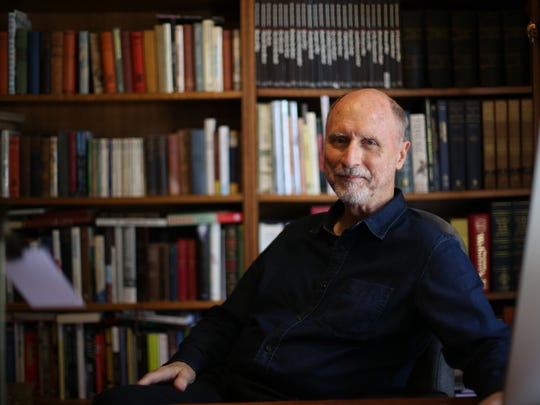 """Pulitzer Prize-winning writer Robert Olen Butlerat his home, Rosewood Plantation, in the tiny Jefferson County town of Capps. His latest in his mystery series is """"Paris in the Dark."""""""