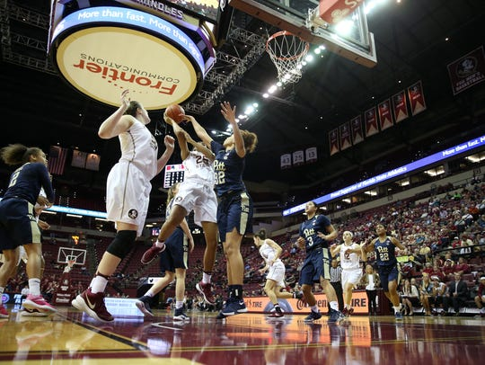 FSU's Ama Degbeon is fouled by Pittsburg's Kalista