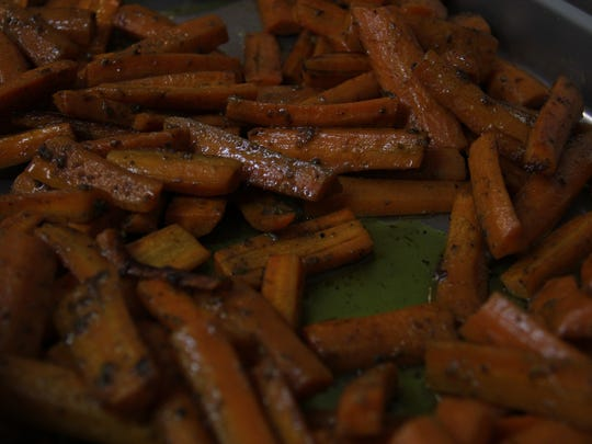 Herb tosses carrots in ras el hanout, a North African spice mix made with cumin, cayenne and allspice.