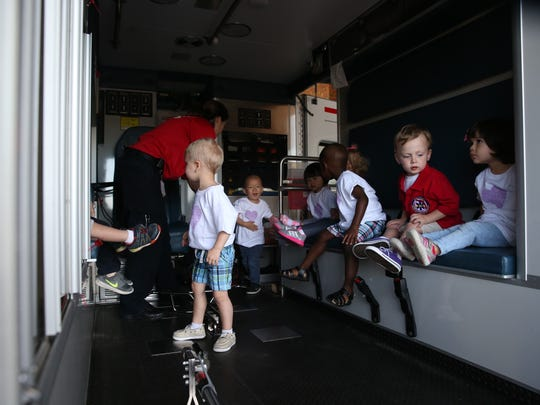 Dayton Wells Bench, 2 (in red), sits on a Leon Country EMS ambulance with classmates at Scottsdale Academy on Tuesday. Dayton was chosen as the local ambassador March of Dimes, an honorary position meant to raise awareness for premature child birth. Dayton was born 3 months early, weighing under 3 pounds and spent 49 days in the Neonatal Intensive Care Unit at Tallahassee Memorial Hospital.
