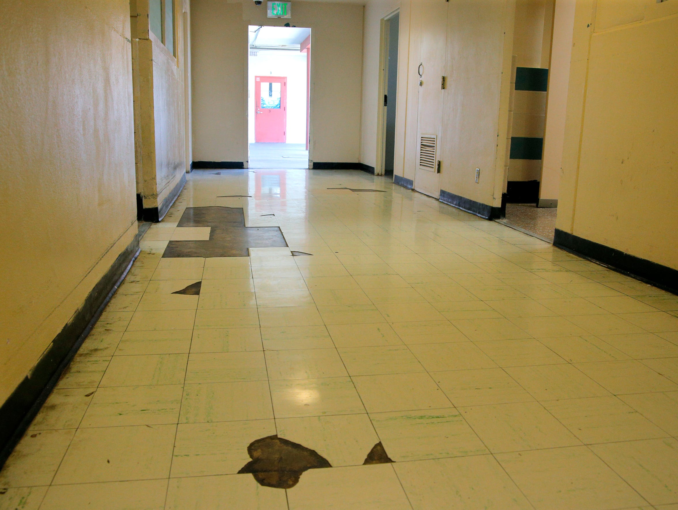 The existing juvenile hall has missing and broken tiles,