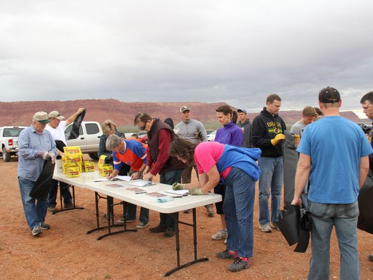 """Volunteers with """"Just Serve,"""" a community outreach of The Church of Jesus Christ of Latter-day Saints' Public Affairs Council, sign up for a cleanup activity at the Warner Valley recreation area Saturday, April 8."""