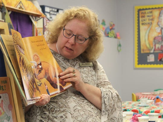 Carlsbad Public Library youth services librarian Beth Nieman reads a book about manners and friendships at the preschool story time on Tuesday.