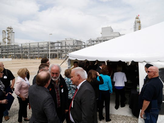 Business and community leaders gather under for opening remarks Wednesday, April 19, 2017, before a ribbon cutting ceremony for the Iowa Fertilizer Company plant in Wever, Iowa.