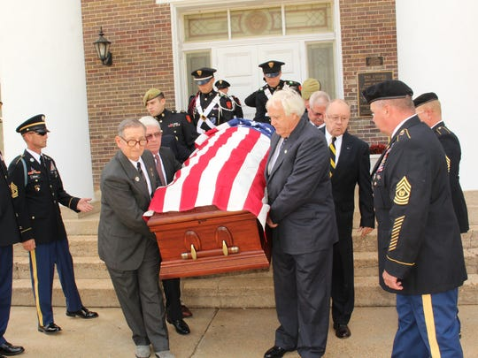 Col. Gibler's casket and its escort.