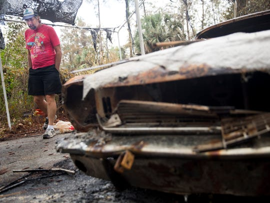 "The home of Barry and  Ivonne Barkman off Garland Road was barely spared by the brush fire in Golden Gate Estates. Barry's 1966 Ford Mustang, however, wasn't so lucky. ""It's kind of heartbreaking,"" he said. ""It's kind of the end of an era."" He had owned the ""Blue Beast"" since he was 15 years old, buying it for $200 from his brother."