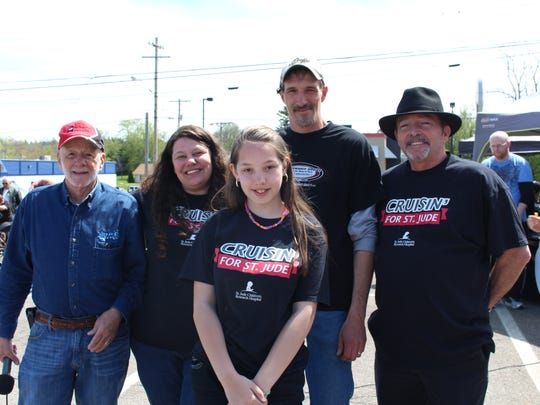 """(From left to right) Chuck Griffith, Karolyn Myers, Destiny Bertram, Terry Myers and """"DJ Bobby T"""" pose for a picture at the eighth annual Race Car Show on Sunday, April 23, 2017. The group started the event  in 2010 to raise money for St. Jude Children's Research Hospital."""