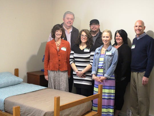 The staff of a new detox facility in Waldo pose in one of the rooms of the facility. Pathways to a Better Life, a substance abuse treatment center in Kiel, is opening the detox facility in Waldo.