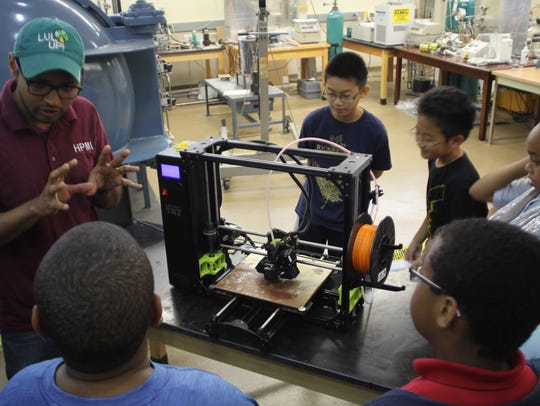 Kids watched a live 3D printing demonstration at the