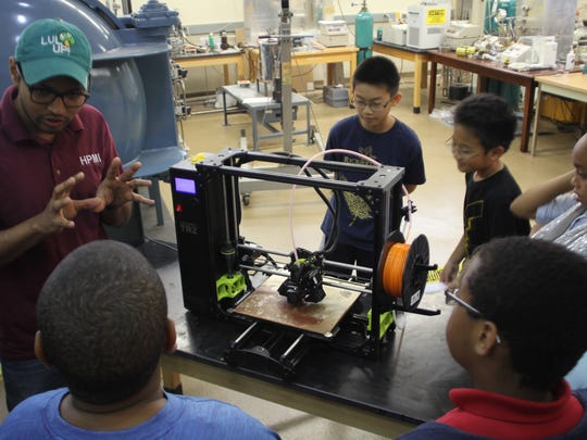 Kids watched a live 3D printing demonstration at the FAMU-FSU College of Engineering Wednesday.