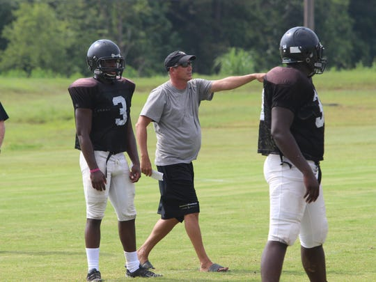 Kenwood's Brian Beaubien directs his football team during practice last fall. Beaubien announced his resignation Wednesday after coaching the Knights the past four years.