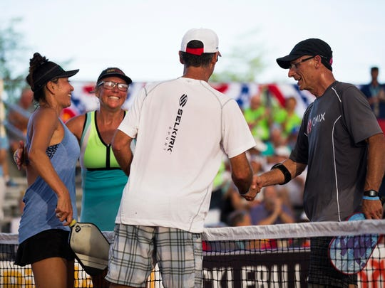 Jennifer and Steve Dawson shake hands with their opponents, Mona Burnett and Tyler Sheffield, after winning the Mixed Senior Pro Gold match of the U.S. Open Pickleball Championship at the East Naples Community Park in East Naples on Friday, April 28, 2017.