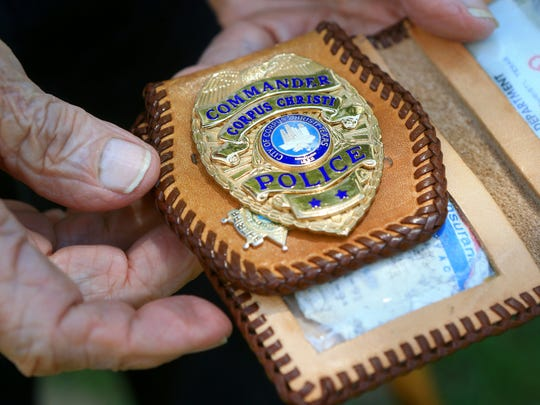 TJ Despain displays one of his badges that he carries in his wallet Thursday Sept. 3, 2015 at his home in Corpus Christi. Despain joined the Corpus Christi Police Department in 1950 and worked at the Nueces County Sheriffs Office for eight years. He served in World War II and was on the USS Franklin when it was damaged by a Japanese dive bomber in 1945.