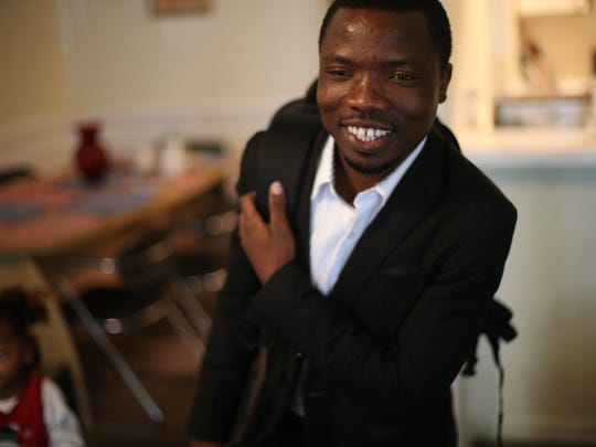Mambo Richard Buchuma heads out for an interview at Chipotle, where he hopes to get a job just a month after resettling his family in Tallahassee.