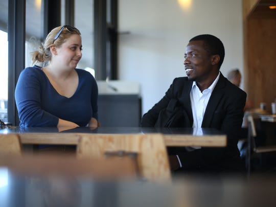 Audrey Vorhees, who works at the International Refugee Committee helps Mambo Richard Buchuma to prepare for a job interview at Chipotle on March 3, 2017.
