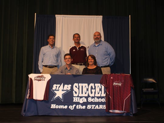 Siegel cross country standout Nikita Fopiano recently signed with Cumberland University. Picturedare front row L to R: Nikita Fopiano and mother Jennifer Fopiano. In the back row (l-r) are Siegel cross country coach Phil Young, Cumberland cross country coach Jim Seckel and Siegel assistant principal and athletic director Ricky Parker.