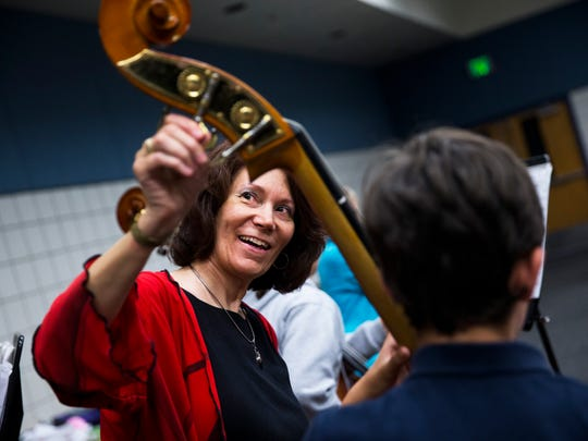 Music teacher Nanette Grant helps tune the instruments for her beginning orchestra students at Pine Ridge Middle School during practice on Monday, May 1, 2017. Grant used a Champions for Learning grant to bring New York composer Lorie Gruneisen to the school and compose a piece for each of the school's three string classes to play during their spring concert performance Wednesday.