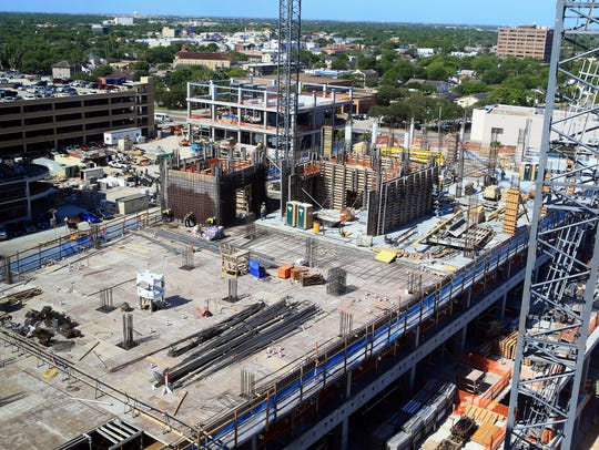 Construction work continues at a tower Tuesday, May