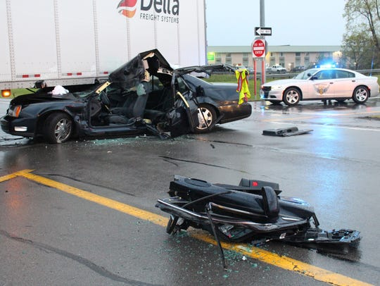 A Cadillac DeVille smashed into a semi truck on U.S.
