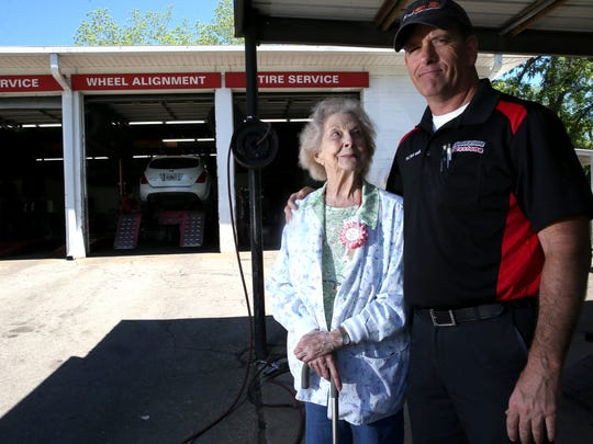 Dorothy Ledbetter, or 'Dot' as she is known around the shop, turned 90 on April 27, 2017 and is still managing her family-run establishment in Quincy, W & L Tire and Wheel, a business that his been in the family since the 1950's. She is seen here standing with her son John Ledbetter.