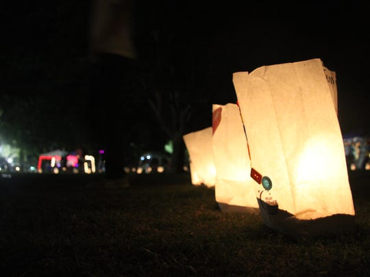 Luminaries were lit Friday night to recognize survivors and those who have died. Each luminary bag told a story of someone who is a cancer survivor or died due to their cancer. Some had pictures of loved ones.
