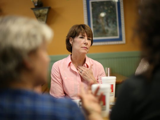 Former congresswoman Gwen Graham listens to a group of educators and parents during a roundtable discussion at the Hopkins Eatery in Midtown on Saturday, May 6, 2017.