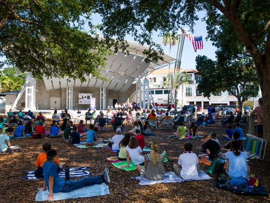 The audience, including classes from nearby Gulfview Middle School, listens to Mayor Bill Barnett read a decree during a special reunion for two World War II veterans at Cambier Park on Tuesday, May 9, 2017.