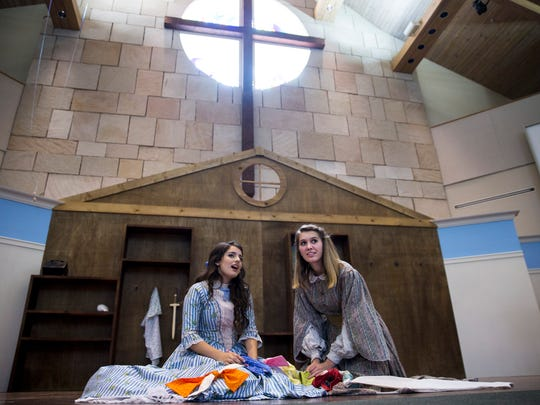 """Faith Hundley, 16, left, sings alongside Athena Kelley, 16, while rehearsing for The Village School of Naples' production of """"Little Women"""" at North Naples United Methodist Church on Monday, May 8, 2017."""