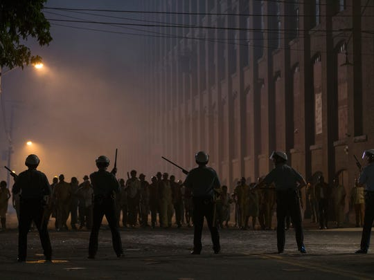 """This image released by Annapurna Pictures shows a scene from the 1967 riots drama """"Detroit."""" Directed by Kathryn Bigelow, the film opens Aug. 4. (Annapurna Pictures via AP)"""