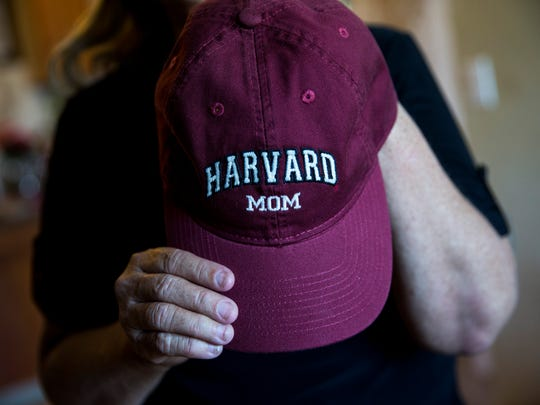 """Maria Torres proudly displays her """"Harvard Mom"""" hat at her home in Immokalee, Florida, on Monday, May 8, 2017. Torres' daughter Jennyfer Gerrero Torres is the first student from Immokalee High School to gain acceptance to Harvard University as an undergraduate."""
