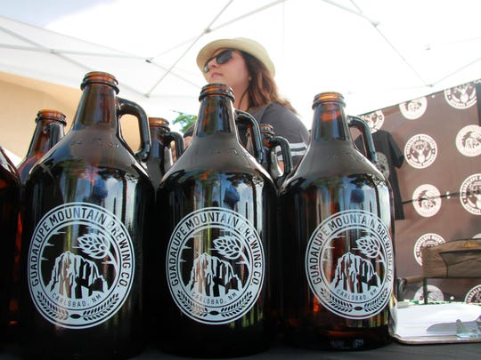 Keely Lott of Guadalupe Mountain Brewing Company speaks to customers at the Microbrew Festival on the Pecos.