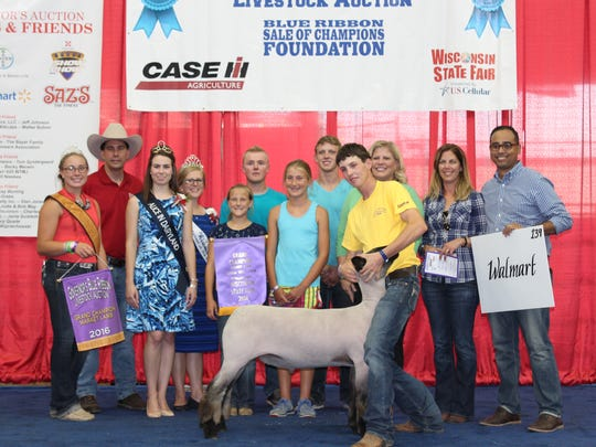 Governor Scott Walker joins the grand champion lamb
