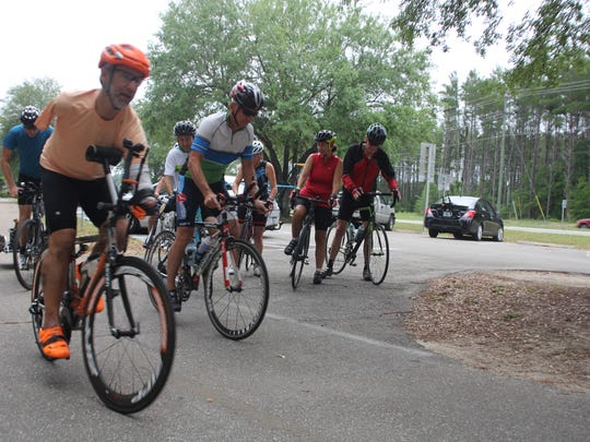 Hector Picard, left, takes off down the St. Marks Trail with a group of Tallahassee cyclists Wednesday.
