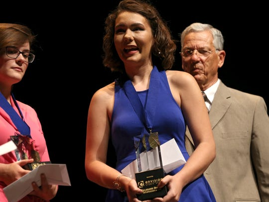Winner of the Best and Brightest Award for Art Alexis Campbell walks the stage at the Ruby Diamond Concert Hall on Wednesday, May 17, 2017.