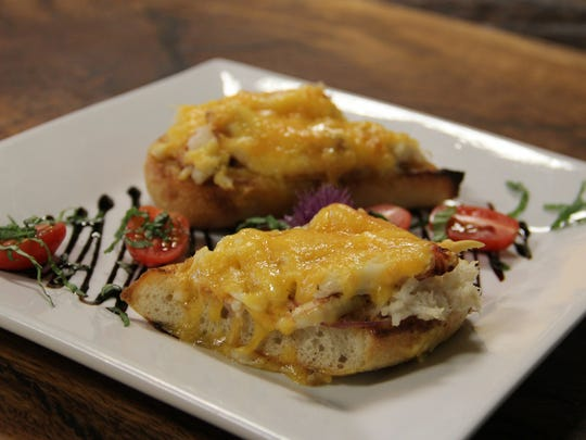 Santiam Wine & Bistro's crab melt comes dressed in light mayo and Old Bay tossed red onions with a shroud of melted cheese. Chef Katie Eckerdt sources her Dungeness from Fitts Seafoods next door.