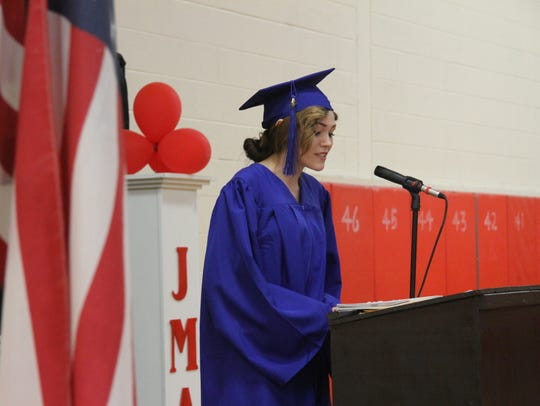 Graduate Caitlin Worden speaks at Thursday's commencement.