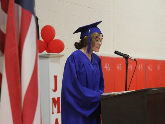 Graduate Caitlin Worden speaks at Thursday's commencement. Worden said graduating would not have been possible without the teachers at JMA.