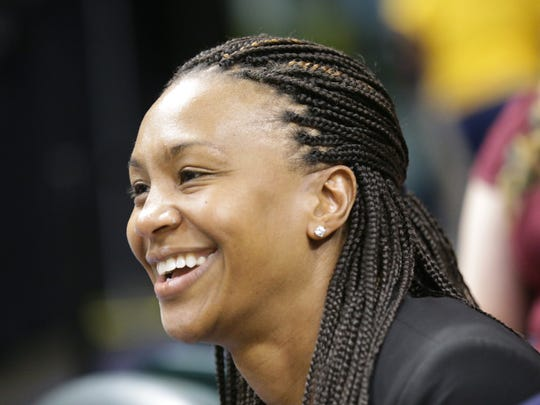 Retired Indiana Fever player Tamika Catchings watches
