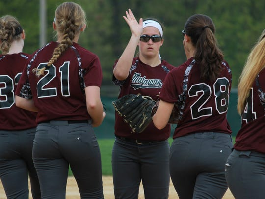 Matawan softball and Lauren Conroy (middle) give high fives.