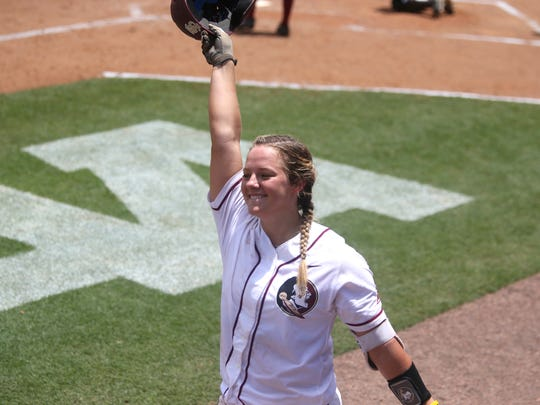 FSU's Anna Shelnutt makes a curtain call after hitting her second home run against Georgia during the Seminoles 7-1 win at JoAnne Graf Field on Saturday, May 20, 2017.